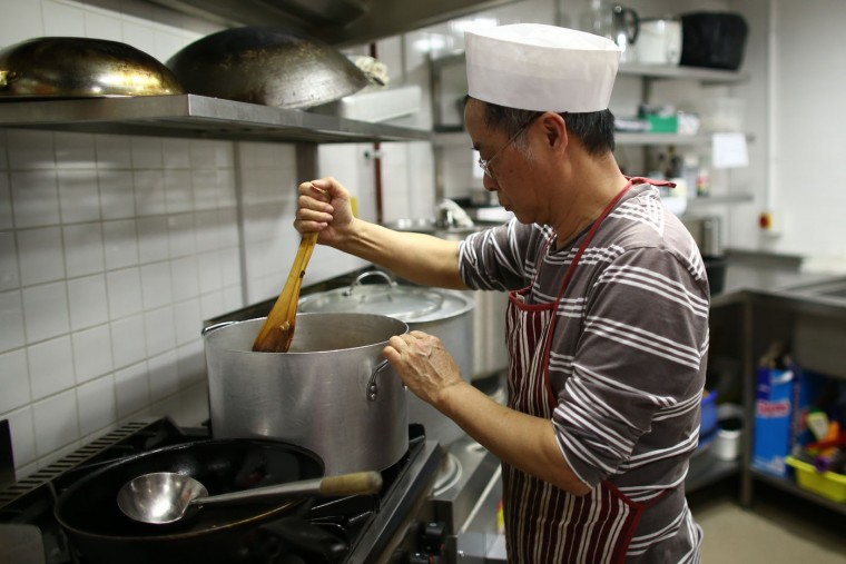 A chef prepares a Chinese New Year lunch at the Chinese community in the UK centre on February 19, 2015 in London, England. This Sunday will see the largest Chinese New Year celebrations in Europe as performers and members of the Chinese community in the UK celebrate the year of the sheep. (Photo by Carl Court/Getty Images)