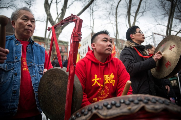 Revelers celebrate the start of the Chinese New Year on February 19, 2015 in New York City. Depending on the translation in to English, the animal that marks the year 2015 is up for debate: goat, sheep and ram have all been used. (Photo by Andrew Burton/Getty Images)