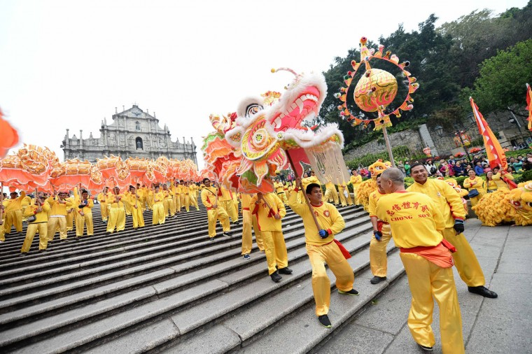 People perform the dragon dance to celebrate the Year of Sheep in Macao, south China, on Thursday, Feb. 19, 2015, the first day of Chinese lunar new year. (Cheong Kam Ka/Xinhua/Zuma Press/TNS)