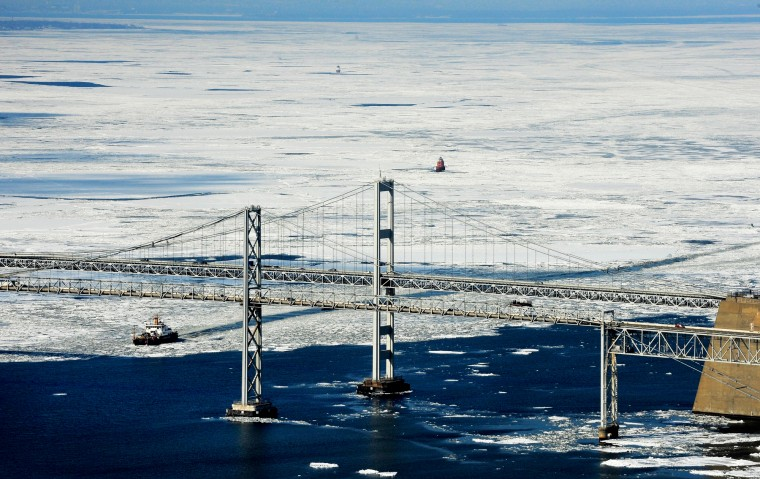 A ship makes its way south through the ice across the Chesapeake Bay toward the Bay Bridge. (Lloyd Fox/Baltimore Sun)