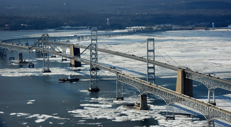 A ship heading south on the Chesapeake Bay passes under the Bay Bridge. (Lloyd Fox/Baltimore Sun)