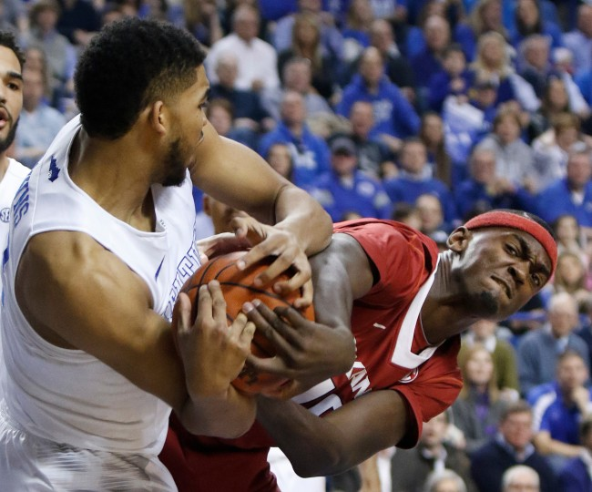 Kentucky's Karl-Anthony Towns, left, and Arkansas' Bobby Portis battle for possession during the first half of an NCAA college basketball game in Lexington, Ky. (James Crisp/Associated Press)