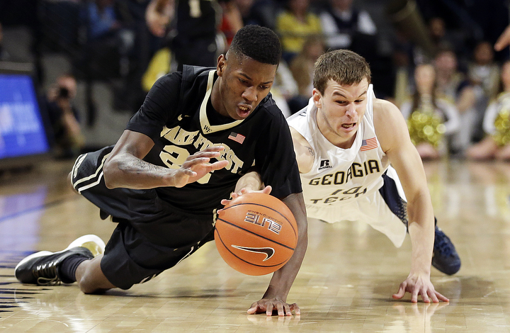 Wake Forest's Cornelius Hudson, left, dives for a loose ball with Georgia Tech's Travis Jorgenson in the second half of an NCAA college basketball game in Atlanta. Georgia Tech won 73-59. (David Goldman/Associated Press)
