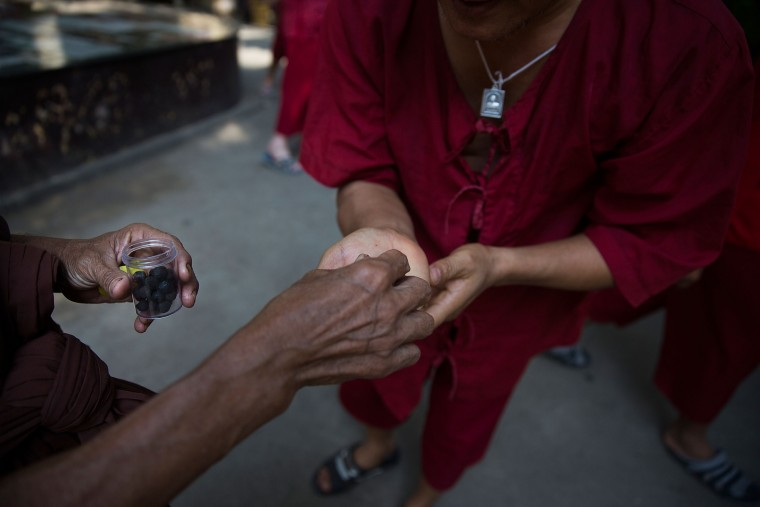 Herbal medicine is handed to a drug rehabilitation patient at Wat Tham Krabok in Saraburi, Thailand. Wat Tham Krabok is the largest free drug rehabilitation center in Thailand and offers its 7 to 28 day detoxification courses to both locals and foreigners. (Taylor Weidman/Getty Images AsiaPac)