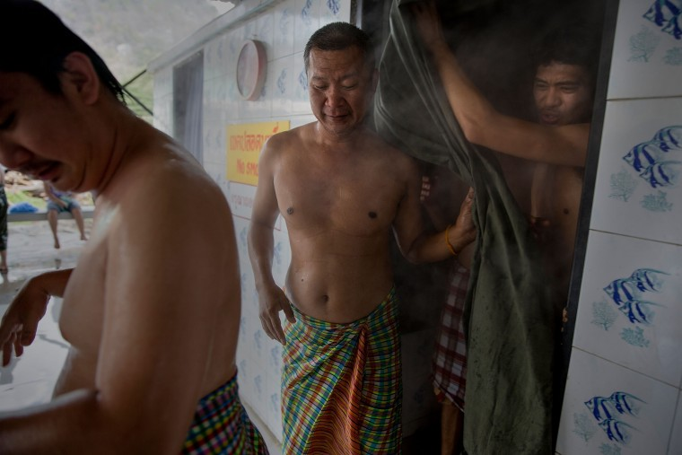 Thai drug rehabilitation patients exit a steam bath designed to detoxify the body at Wat Tham Krabok in Saraburi, Thailand. Wat Tham Krabok is the largest free drug rehabilitation center in Thailand and offers its 7 to 28 day detoxification courses to both locals and foreigners. (Taylor Weidman/Getty Images AsiaPac)