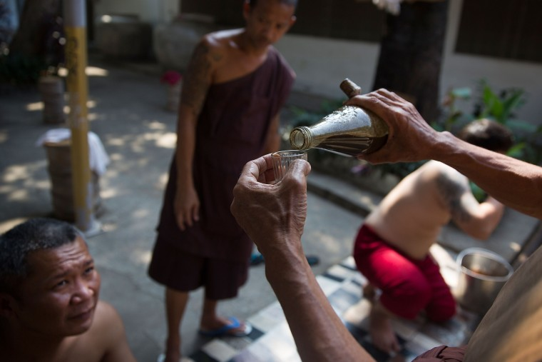 A secret herbal concoction which induces vomiting is poured for a Thai drug rehabilitation patient at Wat Tham Krabok in Saraburi, Thailand. Wat Tham Krabok is the largest free drug rehabilitation center in Thailand and offers its 7 to 28 day detoxification courses to both locals and foreigners. (Taylor Weidman/Getty Images AsiaPac)