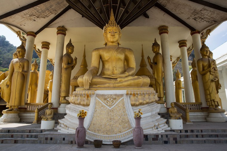 Enormous golden Buddhist statues stand at the entryway to one of the temples at Wat Tham Krabok in Saraburi, Thailand. Wat Tham Krabok is the largest free drug rehabilitation center in Thailand and offers its 7 to 28 day detoxification courses to both locals and foreigners. (Taylor Weidman/Getty Images AsiaPac)