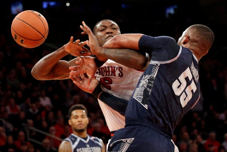 Georgetown guard Jabril Trawick (55) and St. John's forward Chris Obekpa (12) battle for the ball during the first half of an NCAA college basketball game at Madison Square Garden in New York. Both players received technical fouls. (Mary Altaffer/Associated Press)