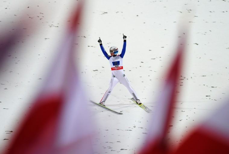 Rune Velta of Norway celebrates winning the gold medal in the Men's Team HS134 Large Hill Ski Jumping during the FIS Nordic World Ski Championships at the Lugnet venue in Falun, Sweden. (Matthias Hangst/Getty Images)
