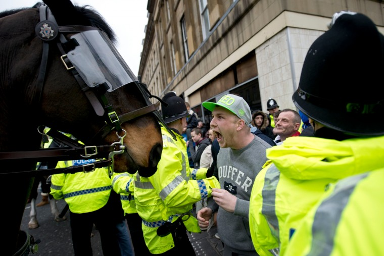 "A protester shouts in the face of a police horse following a protest by the UK branch of the German group 'Pegida', in the city centre of Newcastle upon Tyne, Northern England. The German-based PEGIDA movement, which opposes what it calls the ""Islamisation"" of Europe, was staging its first demonstration on British soil. (Oli Scarff/AFP-Getty Images)"