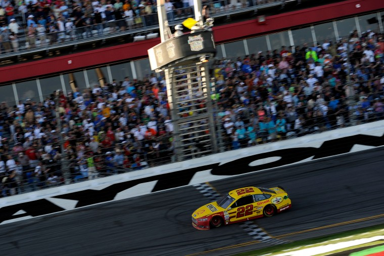 Joey Logano, driver of the #22 Shell Pennzoil Ford, takes the checkered flag to win the NASCAR Sprint Cup Series 57th Annual Daytona 500 at Daytona International Speedway in Daytona Beach, Florida. (Jared C. Tilton/Getty Images North America)
