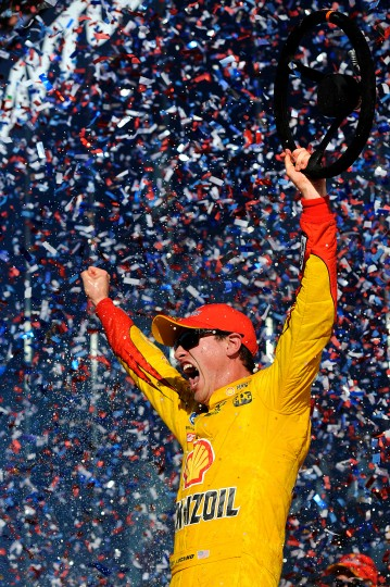 Joey Logano, driver of the #22 Shell Pennzoil Ford, celebrates in victory lane after winning the NASCAR Sprint Cup Series 57th Annual Daytona 500 at Daytona International Speedway in Daytona Beach, Florida. (Photo by Jared C. Tilton/Getty Images)