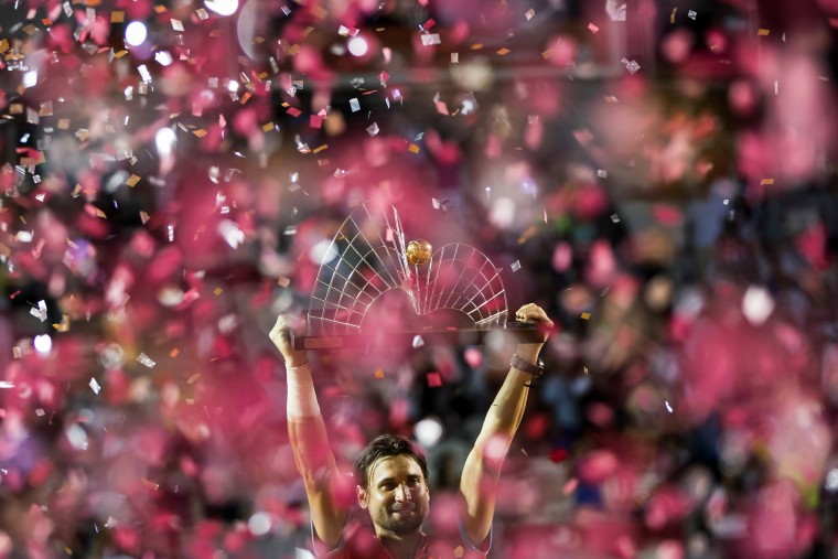 David Ferrer of Spain holds up his trophy after defeating Fabio Fognini of Italy 6-2, 6-3 in the Rio Open tennis tournament men's final match, in Rio de Janeiro, Brazil. (Felipe Dana/AP)