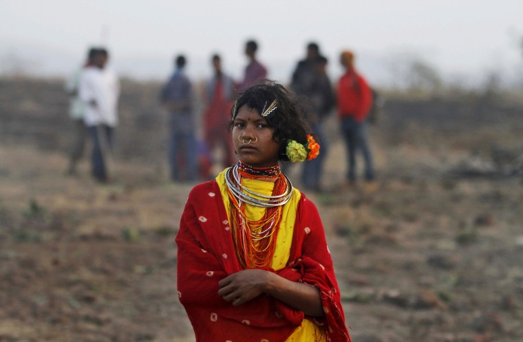 A member of Indiaís Dongria tribe stands during the two-day long Niyamraja Festival atop the Niyamgiri hills near Lanjigarh in Kalahandi district, Orissa state, India. Every year, members of this indigenous group celebrate this festival sacrificing animals and birds in worship of their deity. (Biswaranjan Rout/AP)