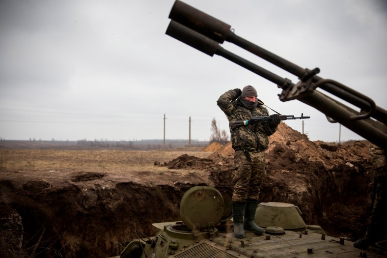 A Ukrainian soldier stands on top of an armored personal carrier in a newly dug trench near the front line of defense against pro-Russian separatists near in the village of Berdianske, Ukraine. Berdianske is on the eastern side of Mariupol, Ukraine - many Ukrainian soldiers believe pro-Russian seperatists will try to take control of the city of Mariupol next in an effort to create a land bridge between Russia and Crimea. (Andrew Burton/Getty Images)