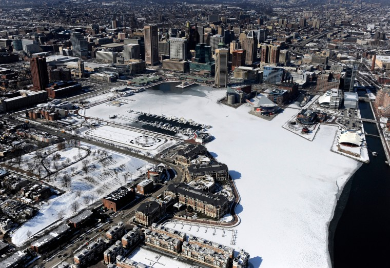 Much of the water in Baltimore's Inner Harbor is covered with ice and snow. (Lloyd Fox/Baltimore Sun)