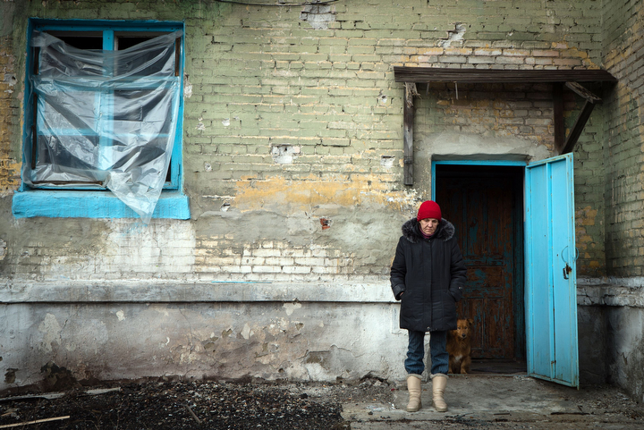 A woman stands outside her house in the eastern Ukrainian town of Vuglegirsk in the Donetsk region. Kiev accused pro-Russian Ukrainian separatists of massing forces for fresh offensives, with seven civilians and five soldiers killed in the latest fighting in the east. (Andrey Borodulin/AFP-Getty Images)