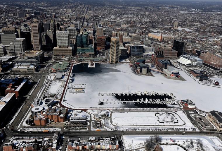 Baltimore sprawls around the mostly frozen Inner Harbor.(Lloyd Fox/Baltimore Sun)