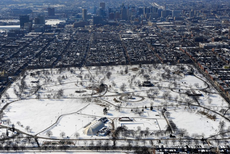 An aerial view of snow-covered Patterson Park with the Baltimore skyline.. (Lloyd Fox/Baltimore Sun video)