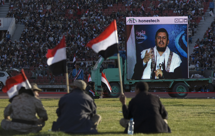"Supporters of Houthi Shiites, who took over the government of Yemen and installed a new committee to govern, listen to a live speech by Abdul-Malik al-Houthi, the leader of Shiite rebels on a big screen during a rally in support of the Houthis, at a sports stadium in Sanaa, Yemen. A group of Gulf countries denounced the Shiite rebel takeover of Yemen as a ""coup"" Saturday, calling for the United Nations to take action as thousands demonstrated in the streets against their power grab. (Hani Mohammed/Associated Press)"