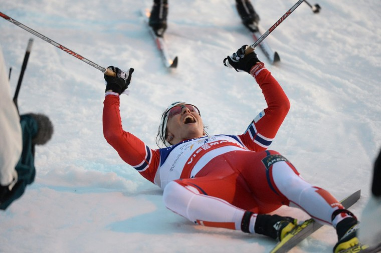 Norway's Marit Bjoergen lies on her back after crossing the finish line to win the Nordic Skiing World Championships in Falun, Sweden, Thursday, Feb. 19, 2015. (AP Photo/Anders Wiklund, TT)