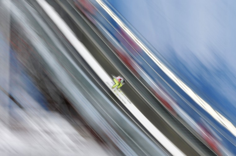 In this photo taken with slow shutter speed Slovenia's Maja Vtic makes an attempt during a training session for the women's ski jumping at the Nordic Skiing World Championships in Falun, Sweden, Wednesday, Feb. 18, 2015. (AP Photo/Matthias Schrader)