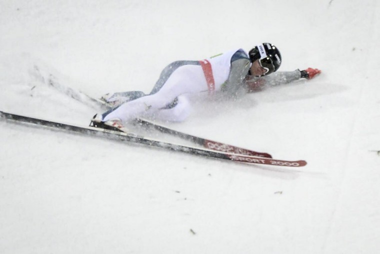 Nicholas Alexander of the U.S crashes during the normal hill HS100 mixed team ski jumping event at the 2015 FIS Nordic Skiing World Championships in Falun, Sweden, Sunday, Feb. 22, 2015. (AP Photo/Fredrik Sandberg, PA Wire)