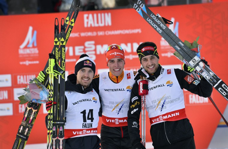 Winner Germany's Johannes Rydzek, center, second=placed Alessandro Pittin. left, of Italy and third-placed Jason Lamy Chappuis of France pose together on the podium after the Nordic Combined Ski event at the Nordic Skiing World Championships in Falun, Sweden, Friday, Feb. 20, 2015. (AP Photo / Anders Wiklund, TT)