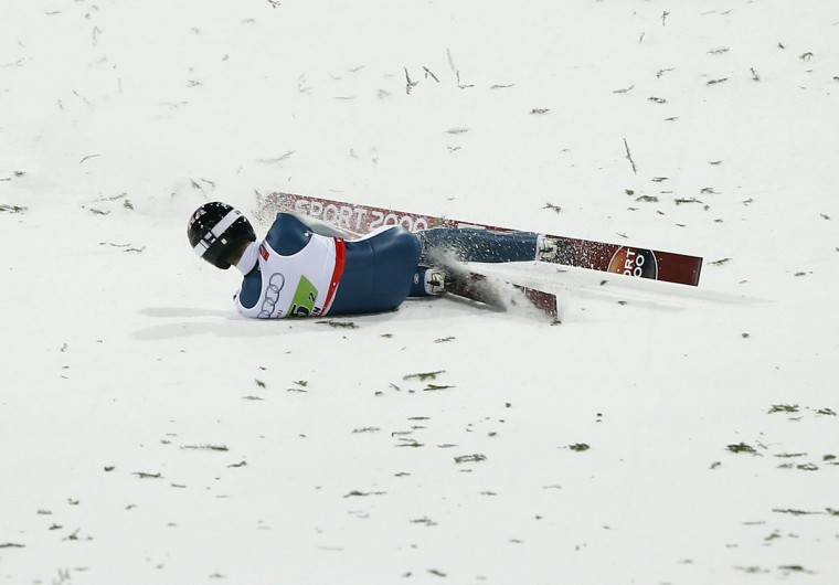 United States' Nicholas Alexander crashes during the Mixed Team Ski Jumping competition at the Nordic Skiing World Championships in Falun, Sweden, Sunday, Feb. 22, 2015. (AP Photo/Matthias Schrader)