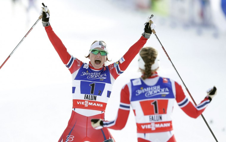 Norway's Maiken Caspersen Falla, left, and Norway's Ingvild Flugstad Oestberg celebrate after crossing the finish line during the Women's Cross Country Team Sprint final at the Nordic Skiing World Championships in Falun, Sweden, Sunday, Feb. 22, 2015. (AP Photo/Matthias Schrader)