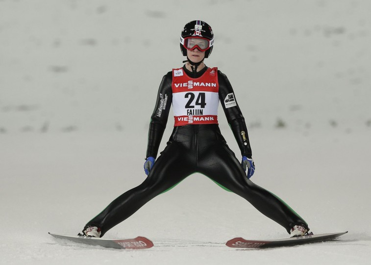 Canada's Taylor Henrich stops after her jump during the Women's Ski Jumping competition at the Nordic Skiing World Championships in Falun, Sweden, Friday, Feb. 20, 2015. (AP Photo/Matthias Schrader)