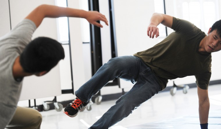 Mt. Hebron seniors Alex Cha, right, 17, and Andrew Park, 17, work on a dance move at their break dancing team's practice in the school cafeteria on Tuesday, Feb. 3, 2015. The team occasionally performs during halftime at school sporting events.