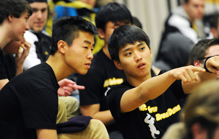 As halftime of the Senior Night girls basketball game approaches at Mt. Hebron High School, Break Dance team members John Oh, 16, right, and Andrew Park, 17, scope out where they will soon perform for the crowd, Thursday, Feb. 19, 2015, in Ellicott City. (Jon Sham/BSMG)