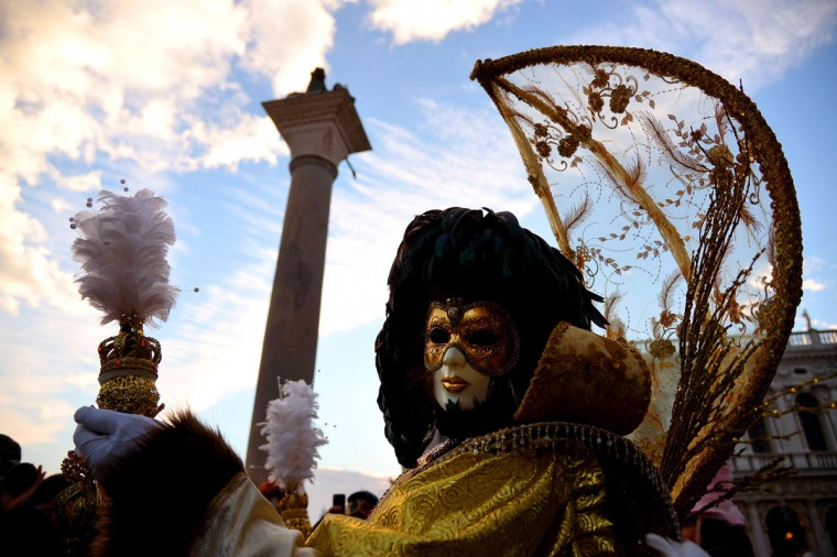 A costumed reveler poses at St Mark's square (Piazza San marco) during the Venice Carnival on February 8, 2015 in Venice. (VINCENZO PINTO/AFP/Getty Images)