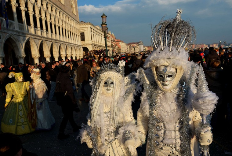 Costumed revelers pose at St Mark's square (Piazza San marco) during the Venice Carnival on February 8, 2015 in Venice. (VINCENZO PINTO/AFP/Getty Images)
