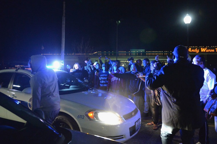 Protestors demonstrate around a police car outside the Ferguson Police Department on March11, 2015 in Ferguson, MO. Protests erupted after the announcement of the resignation of Ferguson Police Chief Tom Jackson earlier in the day. (Photo by Michael B. Thomas/Getty Images)