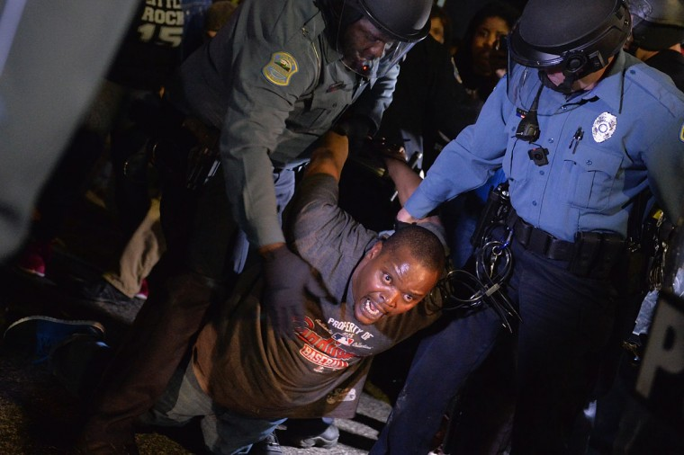 A demonstrator is detained and arrested during a protest outside the Ferguson Police Department on March11, 2015 in Ferguson, MO. Protests erupted after the announcement of the resignation of Ferguson Police Chief Tom Jackson earlier in the day. (Photo by Michael B. Thomas/Getty Images)