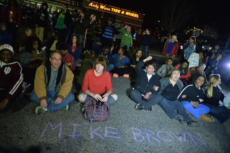 Protestors sit in the street outside the Ferguson Police Department on March11, 2015 in Ferguson, MO. Protests erupted after the announcement of the resignation of Ferguson Police Chief Tom Jackson earlier in the day. (Photo by Michael B. Thomas/Getty Images)