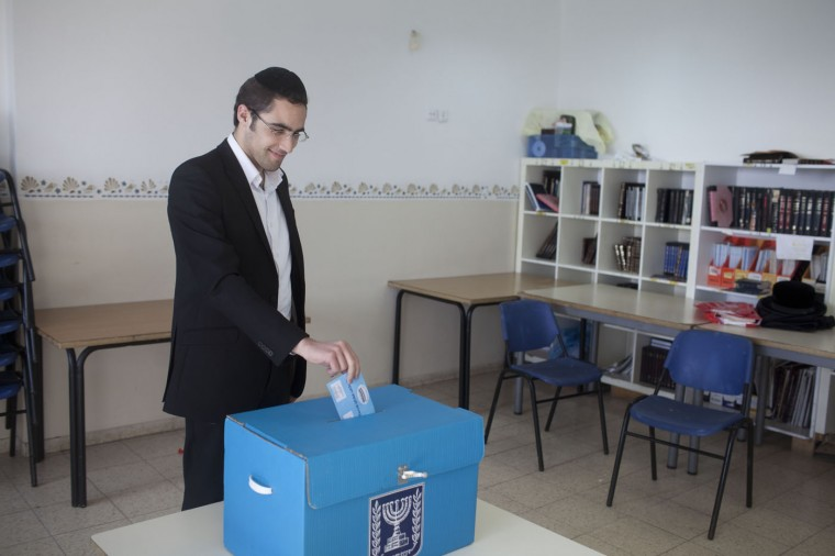 An Orthodox Jewish man casts his ballot at a polling station on election day on March 17, 2015 in Kiryat Ye'arim, Israel. Israel's general election voting has begun today as polls show on that Chairman of the Zionist Union party, Isaac Herzog stands as the only rival to current Prime Minister Benjamin Netanyahu. (Photo by Lior Mizrahi/Getty Images)