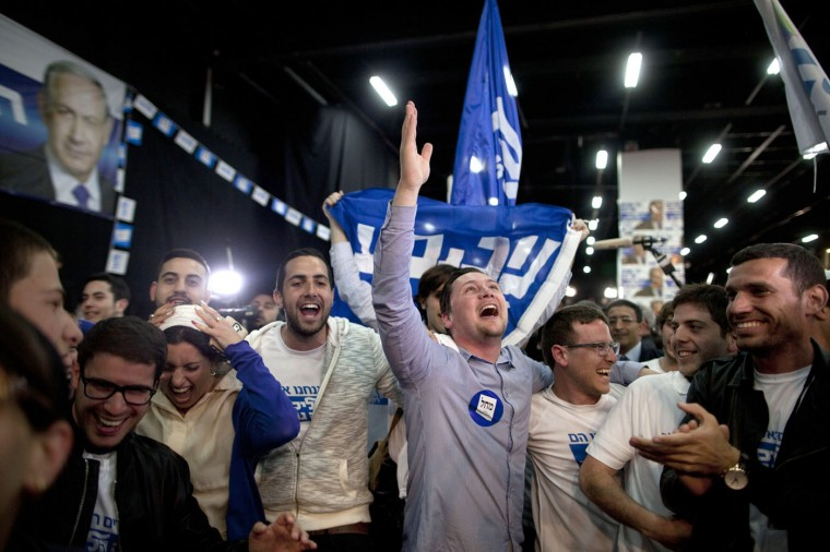 Supporters of Israeli Prime Minister Benjamin Netanyahu celebrate as election results come in at his election campaign headquarters on March 17, 2015 in Tel Aviv, Israel. After the ballot boxes were closed at 10 P.M. Tuesday, exit polls showed the two main contenders, Netanyahu of Likud and Isaac Herzog of the Zionist Union party, were neck and neck with 27 Knesset seats each, with a slight lead for Likud. Netanyahu announces a 'great victory'. (Photo by Lior Mizrahi/Getty Images)