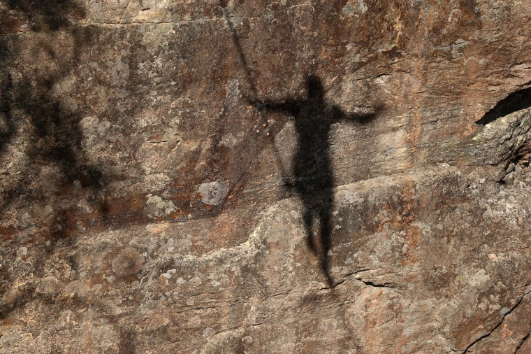 The shadow of a person walking a highline is seen at Corroboree Walls in Mount Victoria on March 8, 2015 in the Blue Mountains, Australia. (Photo by Cameron Spencer/Getty Images)