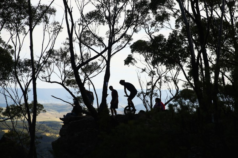 Ben Davis of Australia rides a unicycle at Corroboree Walls in Mount Victoria on March 7, 2015 in the Blue Mountains, Australia. (Photo by Cameron Spencer/Getty Images)