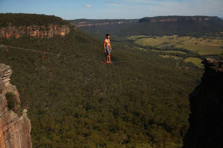 Matt Macelli of Australia walks on a highline rigged between cliffs at Corroboree Walls in Mount Victoria on March 7, 2015 in the Blue Mountains, Australia.(Photo by Cameron Spencer/Getty Images)