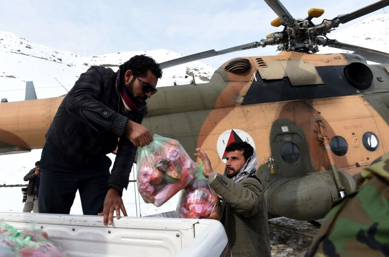 Afghan army personnel carry emergency food supplies to a helicopter to be delivered to avalanche survivors in Panjshir province north of Kabul on March 1, 2015. Afghan President Ashraf Ghani February 28 pledged to set up a relief fund for the victims of avalanches that claimed over 280 lives, and called for international help with the relief effort. (Shah Marai/AFP/Getty Images)