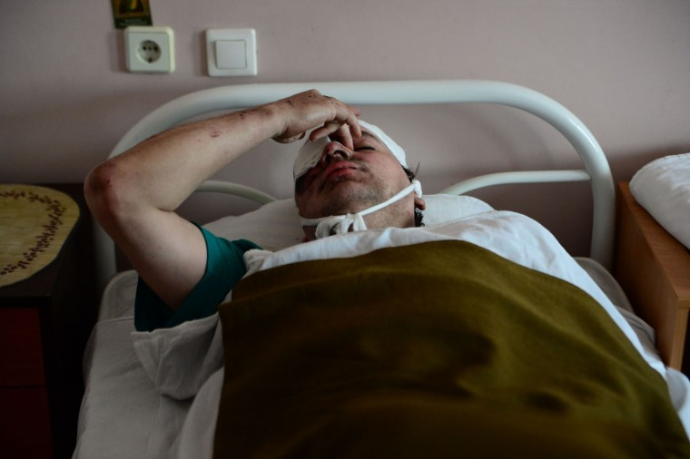 A miner wounded in a blast at the Zasyadko mine lies in a bed at the Republican Center for Traumatology hospital in Donetsk on March 4, 2015. (John Macdougall/AFP/Getty Images)