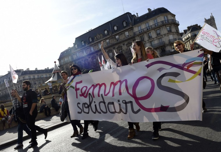 People take part in a parade marking International Women's Day in Paris on March 8, 2015. (Loic Venance/AFP/Getty Images)