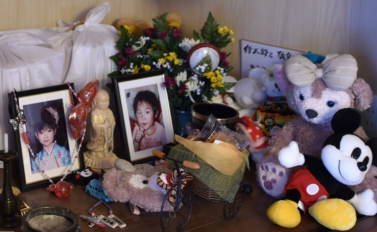 Portraits of Takayuku Ueno's two deceased children, daughter Erika (L) and son Kotaro (R), are displayed on an alter at his newly constructed home at Kaibama area in Minami-soma, north of the Fukushima Daiichi nuclear power plant. In cold drizzle Takayuki Ueno combs a desolate winter beach for the bones of his three-year-old son, unable to move on in his grief until he finds the remains of a boy killed by Japan's monstrous tsunami four years ago. (AFP Photo/Kazuhiro Nogi)