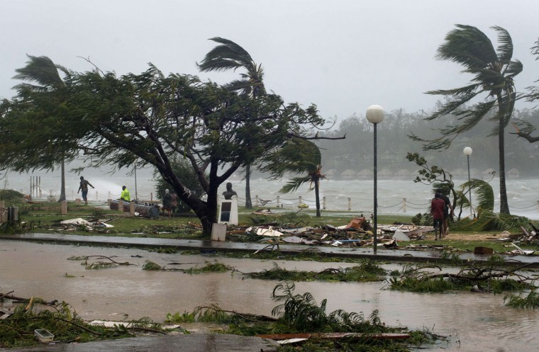 """This handout photo taken and received on March 14, 2015 by UNICEF Pacific shows waves and scattered debris along the coast, caused by Cyclone Pam, in the Vanuatu capital of Port Vila. The huge tropical cyclone smashed into Vanuatu in the South Pacific, terrifying residents and leaving """"complete devastation"""" with fears on March 14 that dozens of people may have died. (UNICEF Pacific/AFP/Getty Images)"""