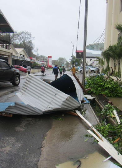 """This handout photo taken and received on March 14, 2015 by UNICEF Pacific shows scattered debris along the street, caused by Cyclone Pam, in the Vanuatu capital of Port Vila. The huge tropical cyclone smashed into Vanuatu in the South Pacific, terrifying residents and leaving """"complete devastation"""" with fears on March 14 that dozens of people may have died. (UNICEF Pacific/AFP/Getty Images)"""