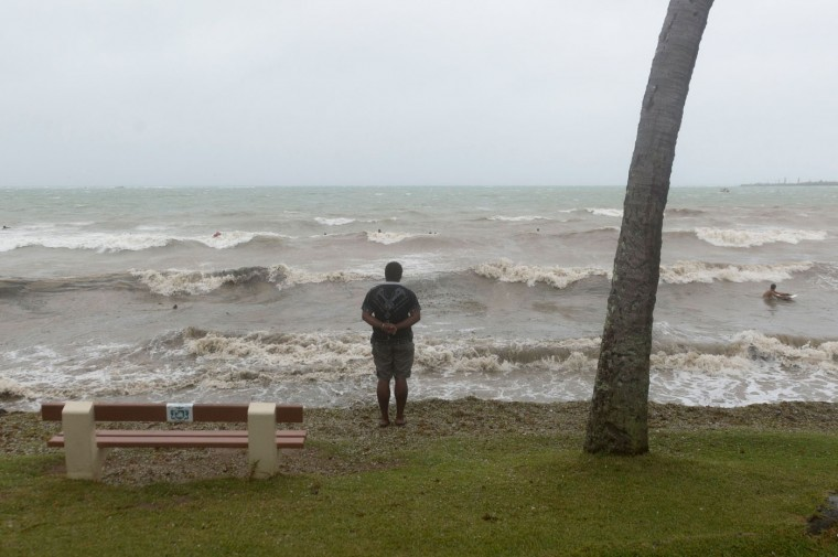 A man looks at the sea on March 14, 2015 in the Anse Vata, south of Noumea, New Caledonia. Rain and wind were observed in the island but the Tropical Cyclone Pam had little effect on Noumea. The maximum category five cyclone hit Vanuatu island, 500 km east of New Caledonia, late on March 13 and early indications suggest widespread damage, including in the capital in Port Vila, with fears dozens of people could have died across the country. (Fred Payet/AFP/Getty Images)